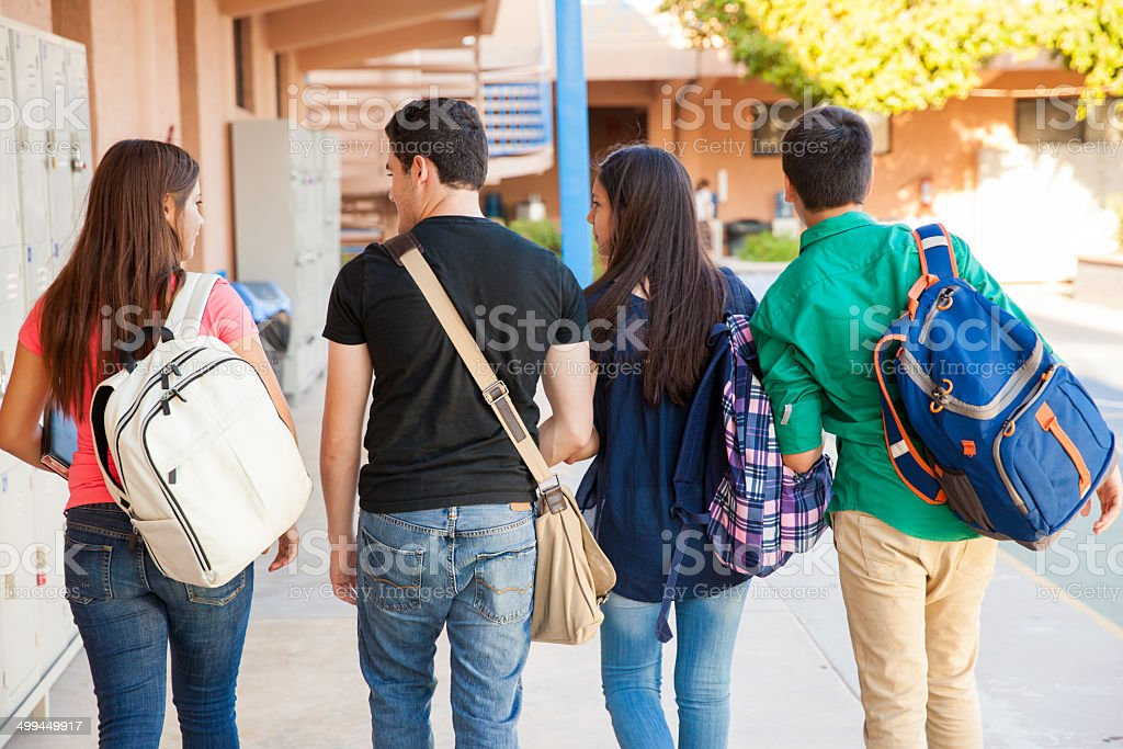 Students in a school hallway stock photo