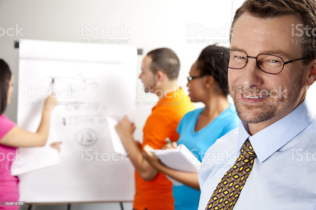 Students in calculus class with instructor royalty-free stock photo