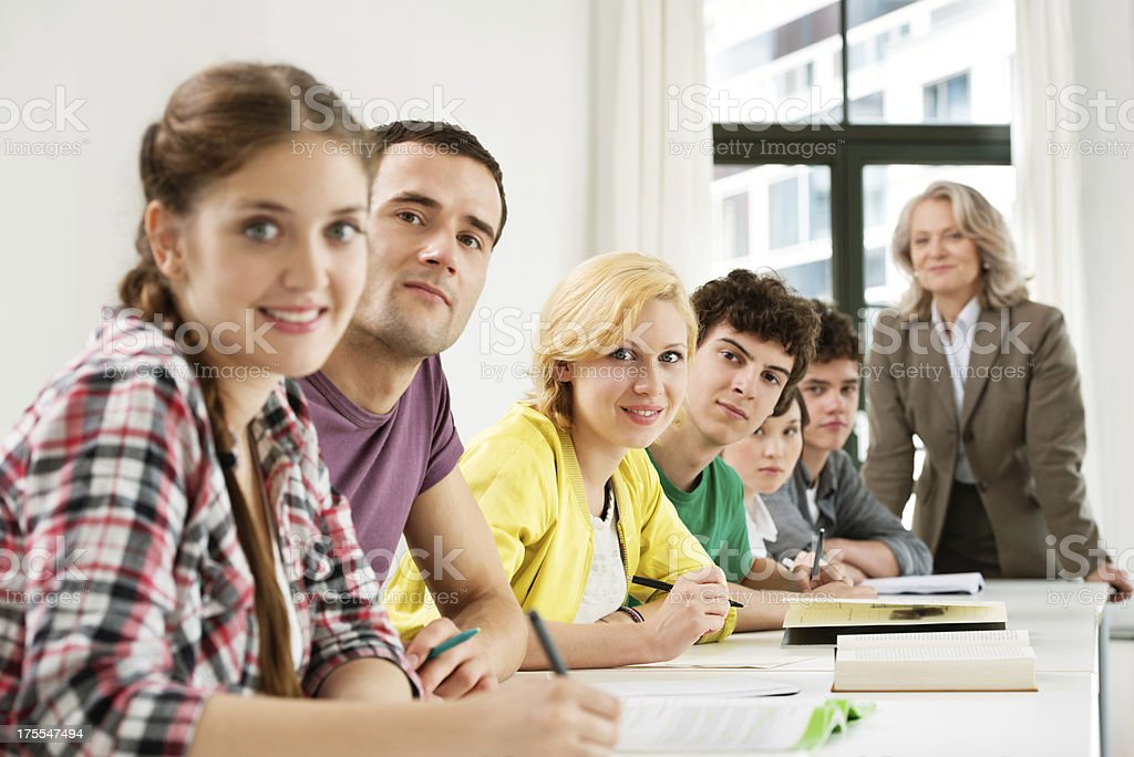 Students In Classroom With Teacher royalty-free stock photo