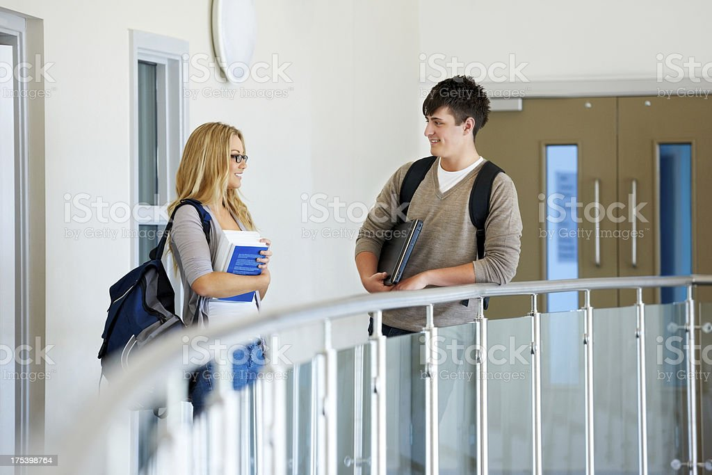 Students in corridor standing by railing royalty-free stock photo