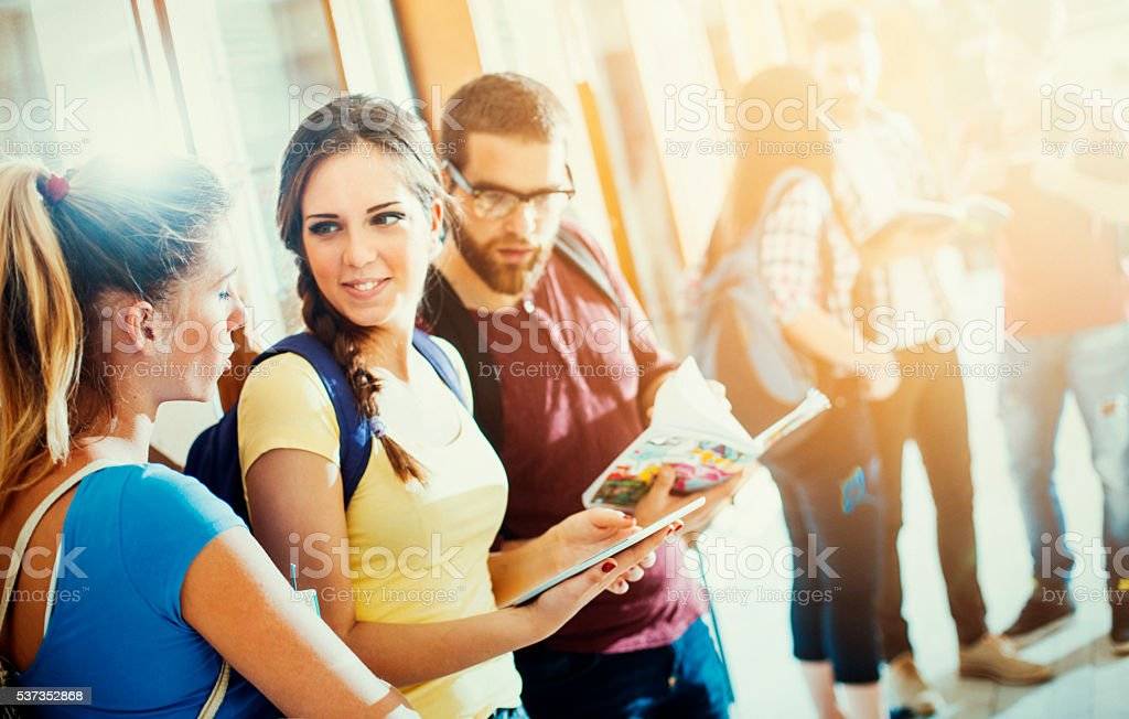 Students in hallway. stock photo