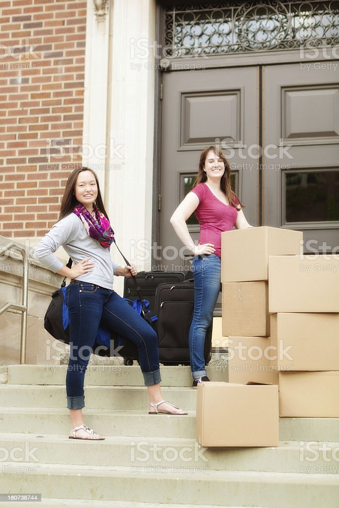 Students in Process of Moving into University Dormitory Vertical royalty-free stock photo
