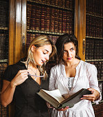 Students in the library studying togetherness