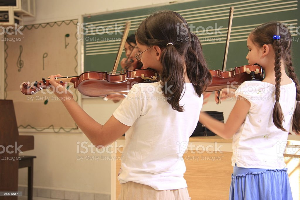Students in the violin lesson royalty-free stock photo