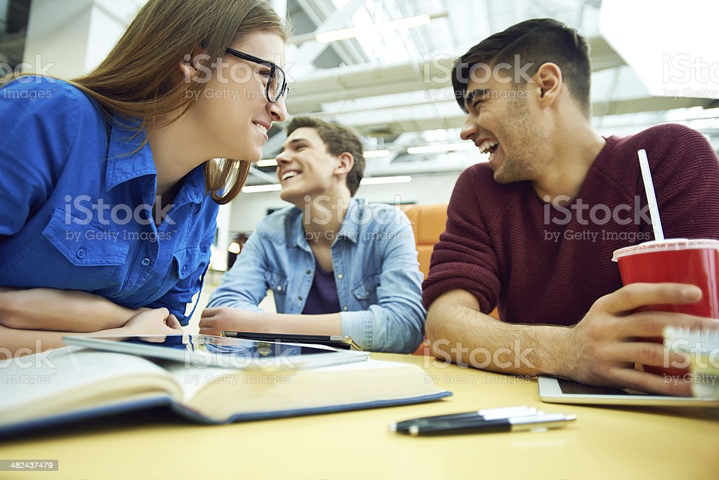 Students laughing over loud royalty-free stock photo