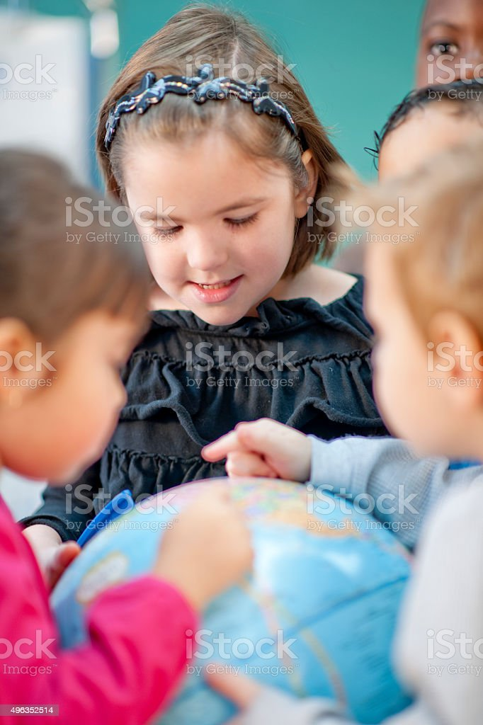 Students Learning Geography Together stock photo