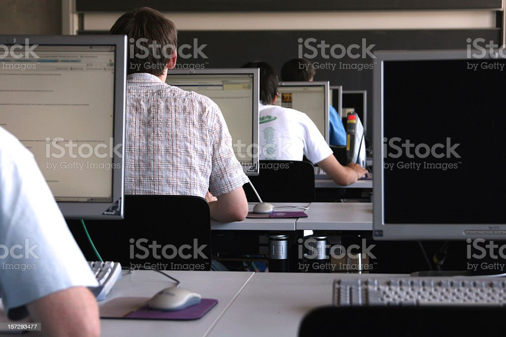 Students learning in a computer room at university. royalty-free stock photo