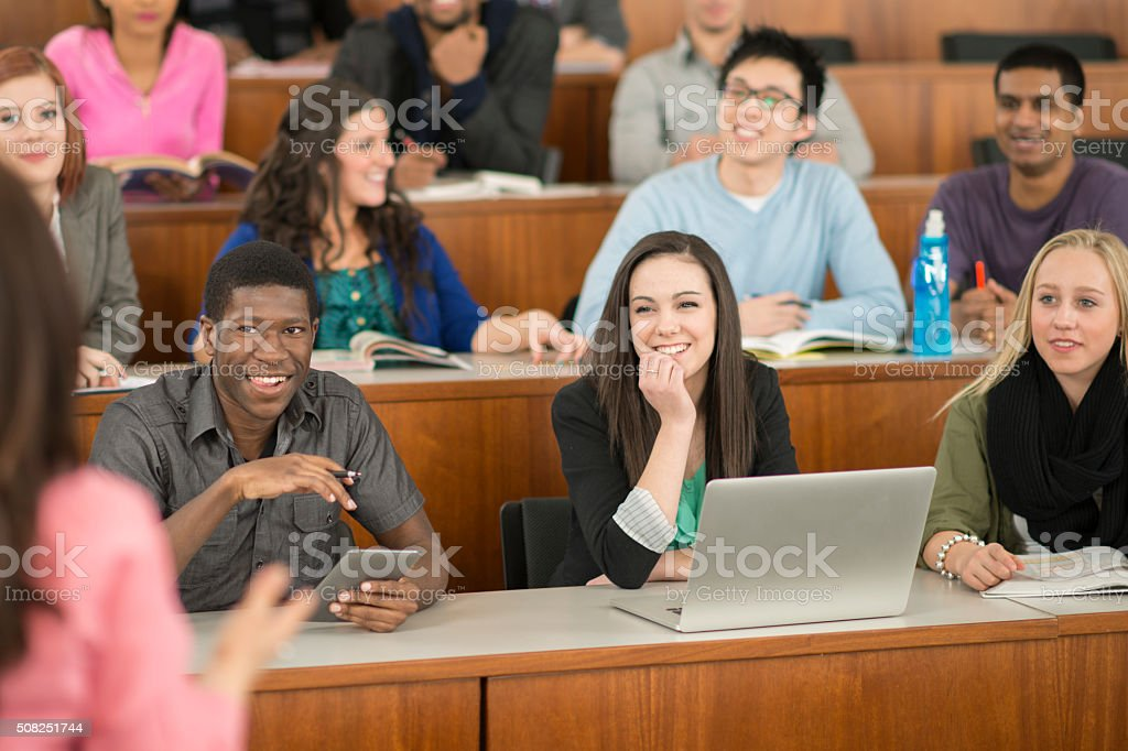 Students Listening to a University Lecture stock photo