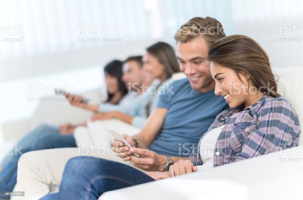 Students living together and relaxing at home stock photo