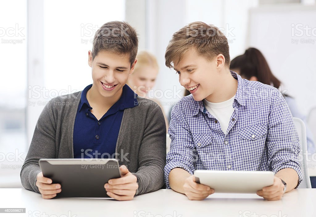 students looking at tablet pc on lecture in school stock photo