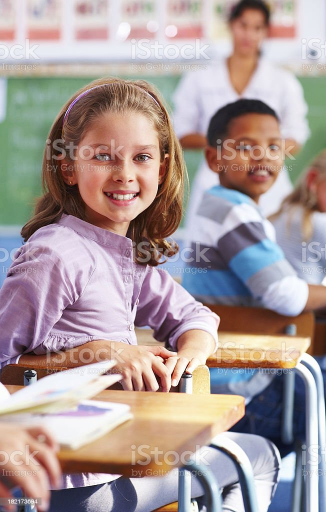 Students looking behind in the classroom royalty-free stock photo