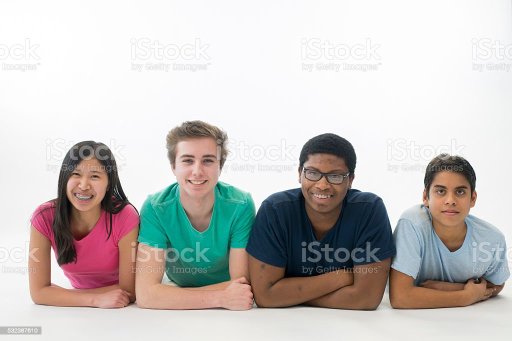 Students Lying in a Row stock photo
