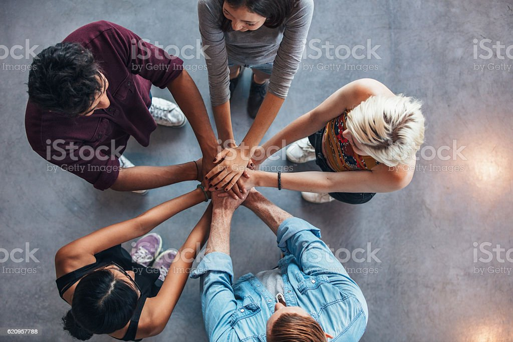 Students making a stack of hands stock photo