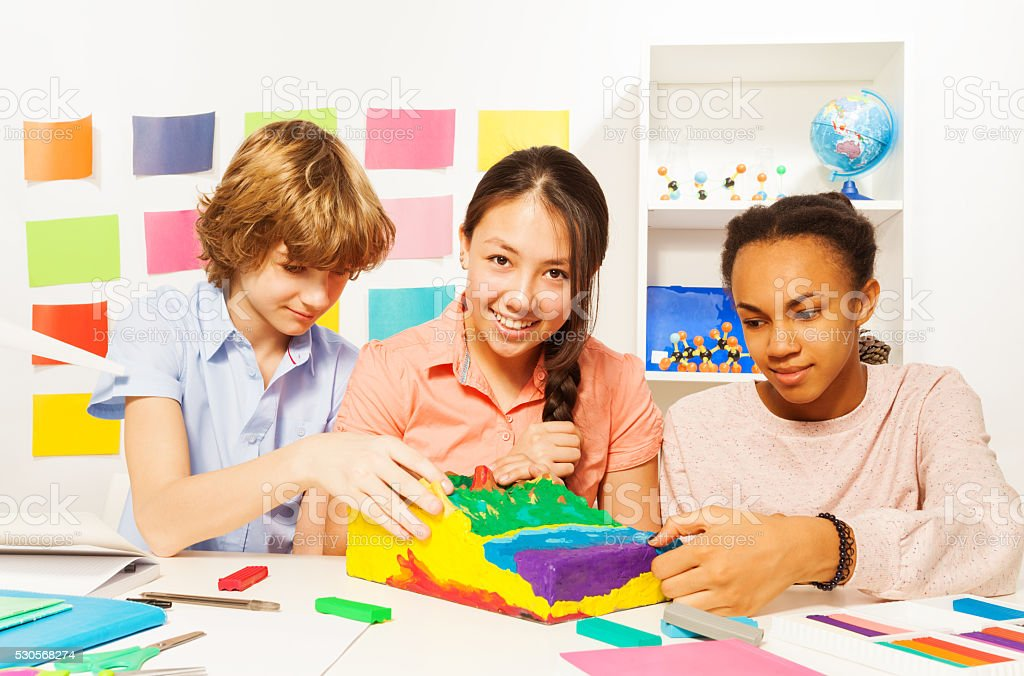 Students modeling surface relief with plasticine stock photo