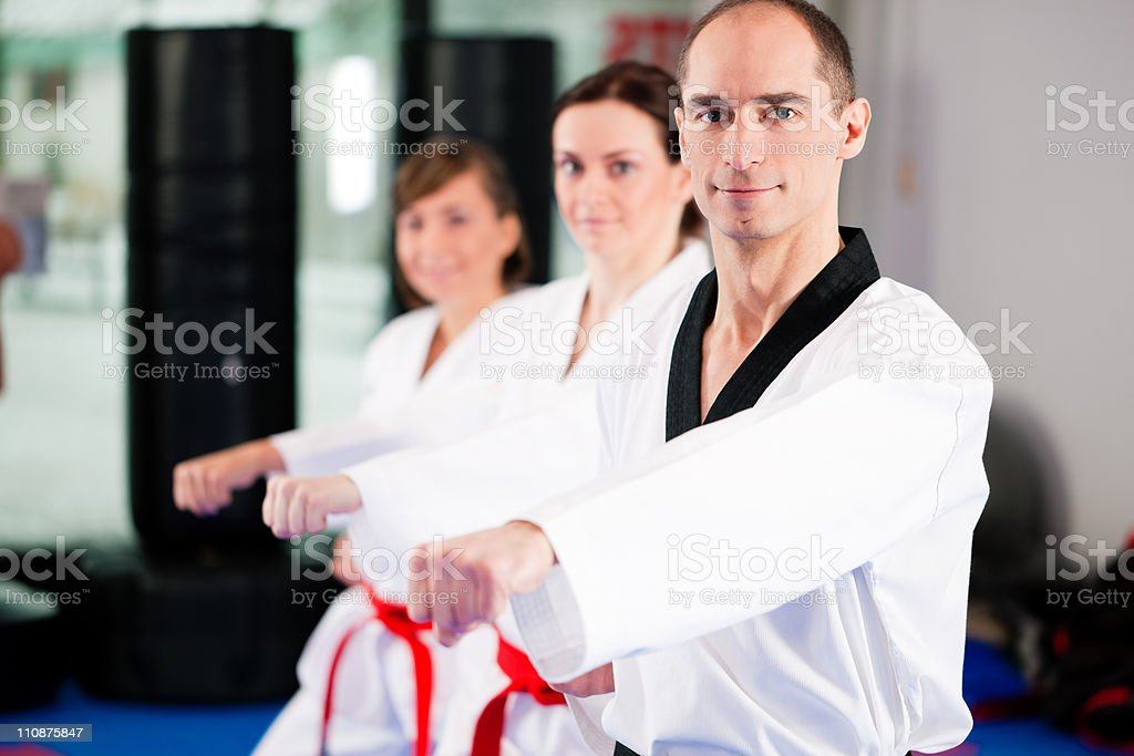 Students of martial arts practicing in studio stock photo