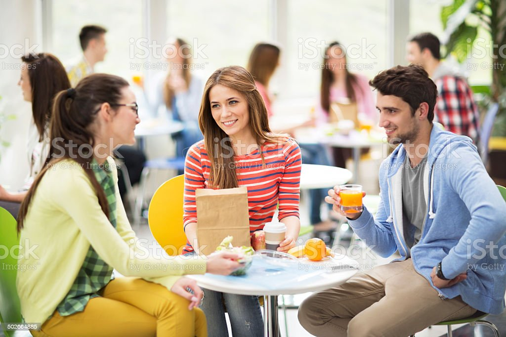 Students on a lunch break. stock photo