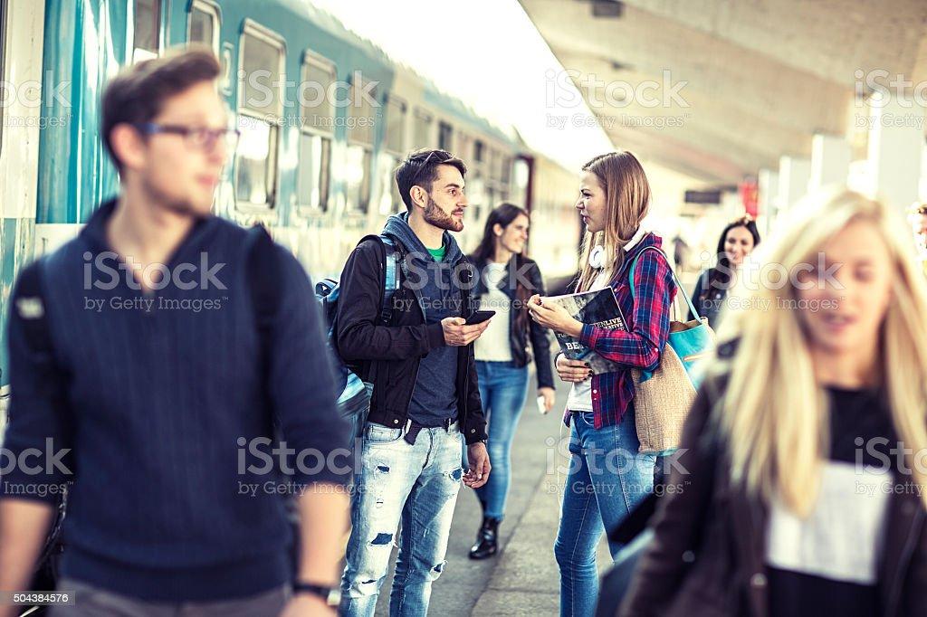 students  on a  train station  platform stock photo