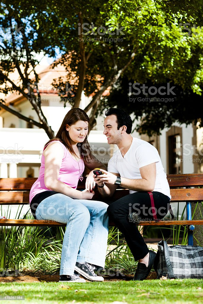 Students on bench chatting royalty-free stock photo
