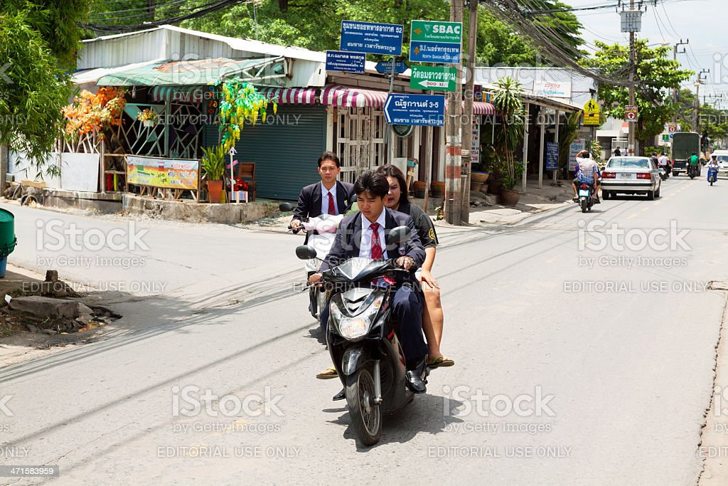 Students on motorcycle royalty-free stock photo