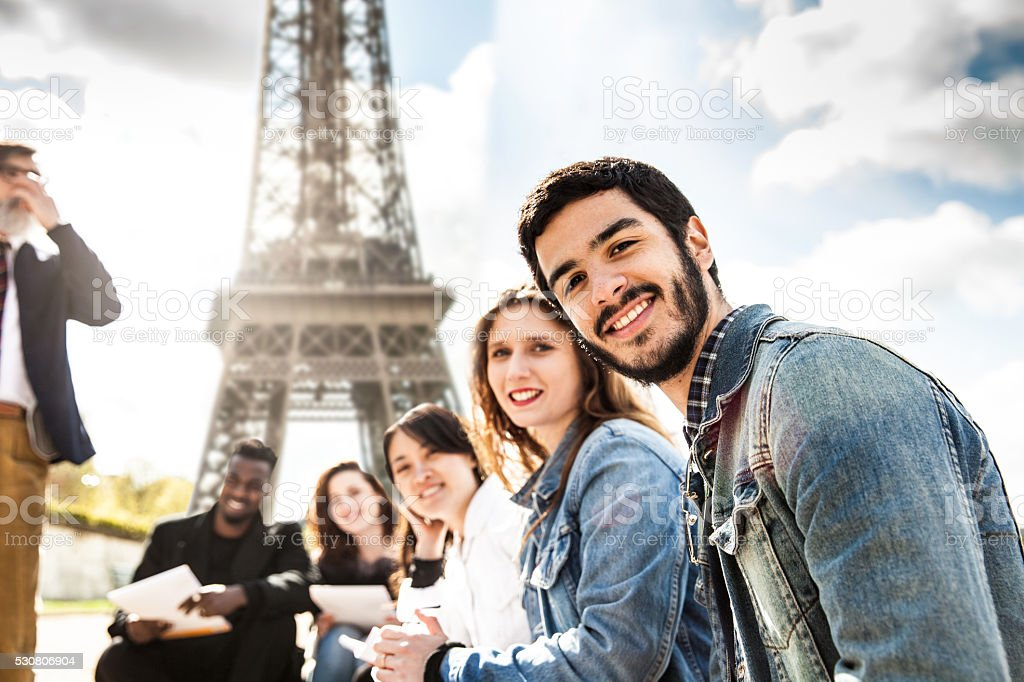 Students on travel in Paris - Tour Eiffel Outdoor lesson stock photo