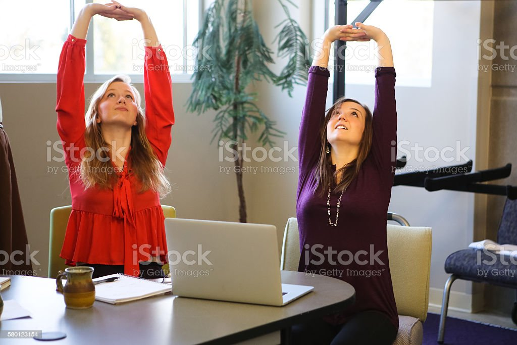 Students or Young Business Women Doing Yoga Stretching Working Studying stock photo