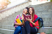 Students outdoor with books
