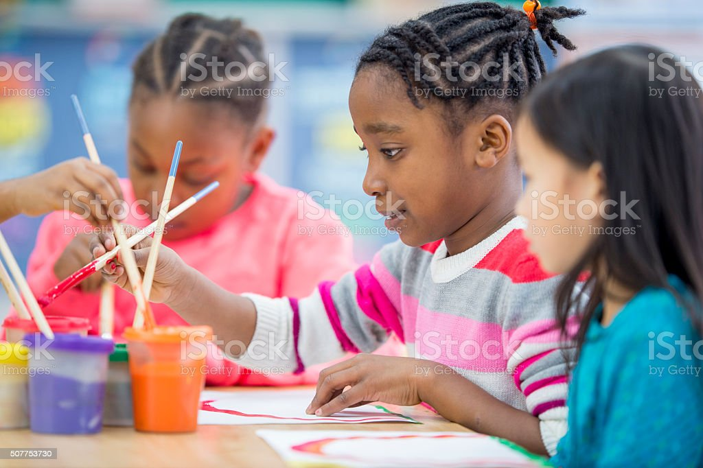 Students Painting for an Art Project stock photo