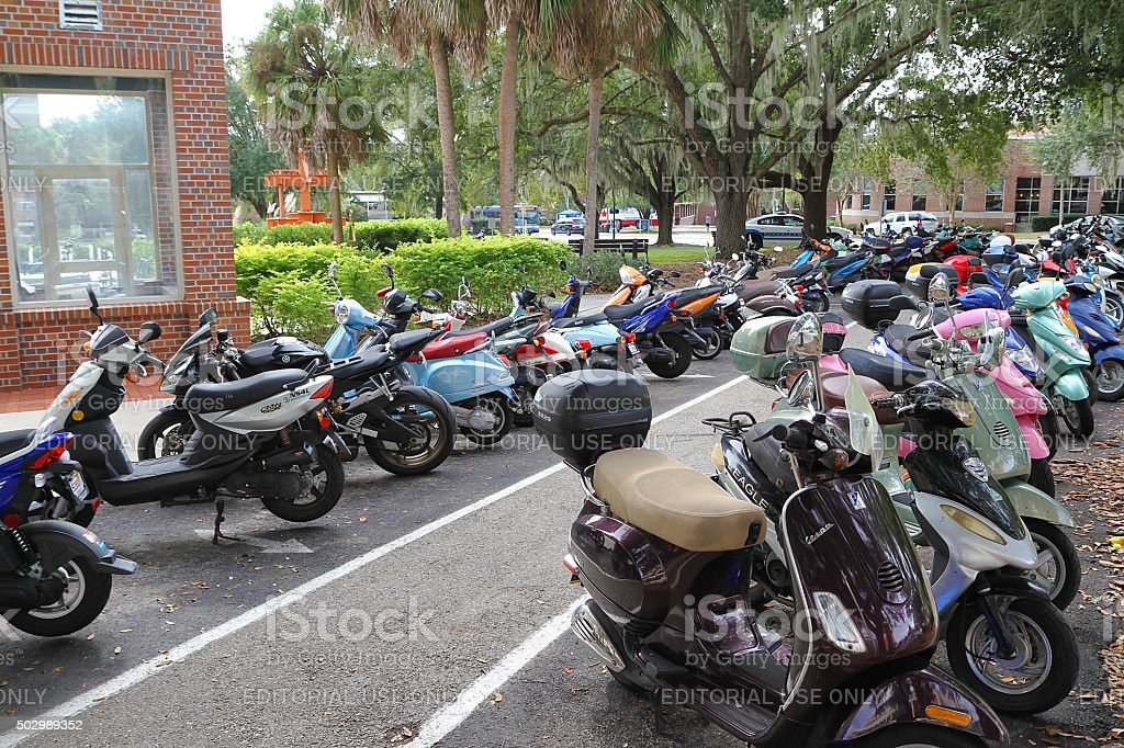 Students park their scooters at the University of Florida stock photo