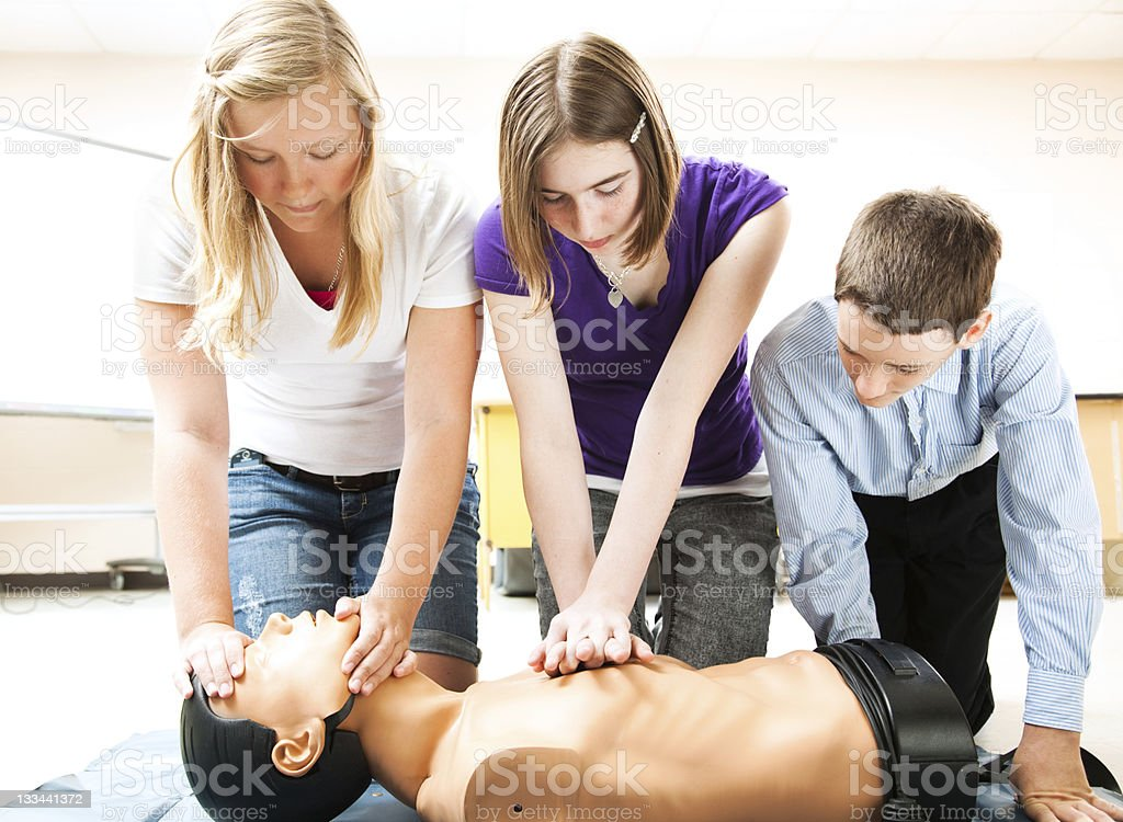Students Practicing CPR Lifesaving royalty-free stock photo