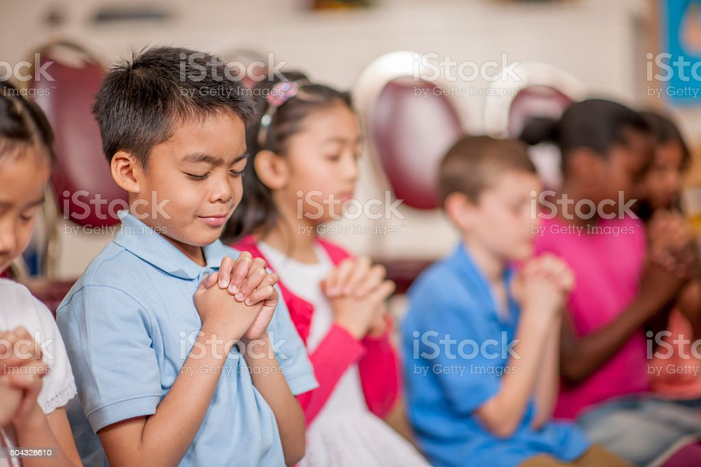 Students Praying at School stock photo