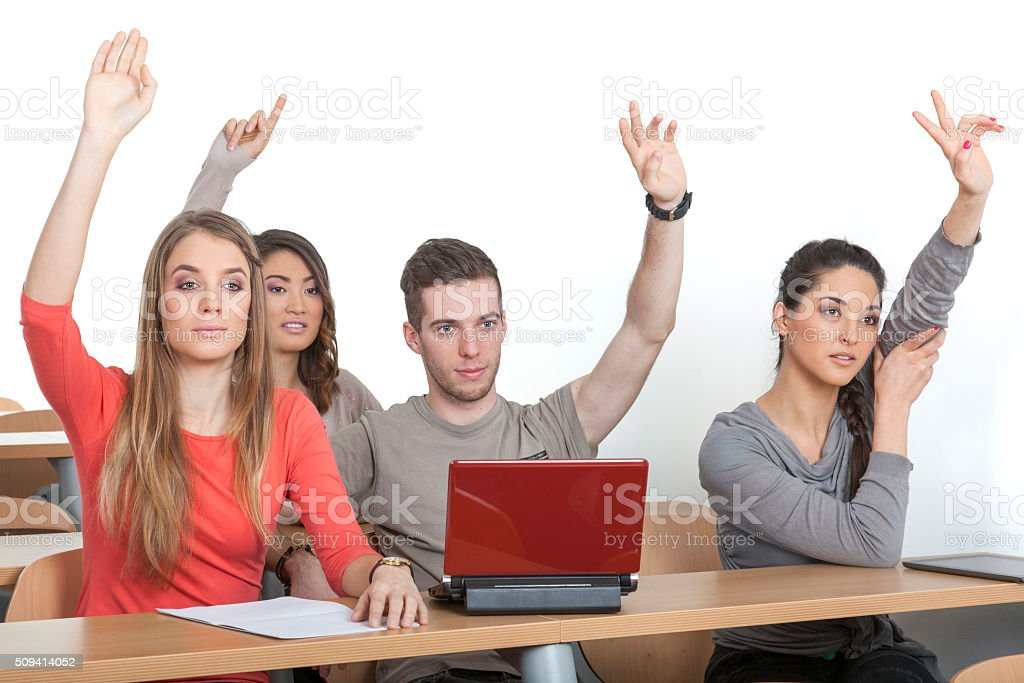 Students put up their hands stock photo