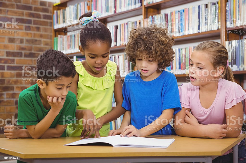 Students reading froma school book stock photo