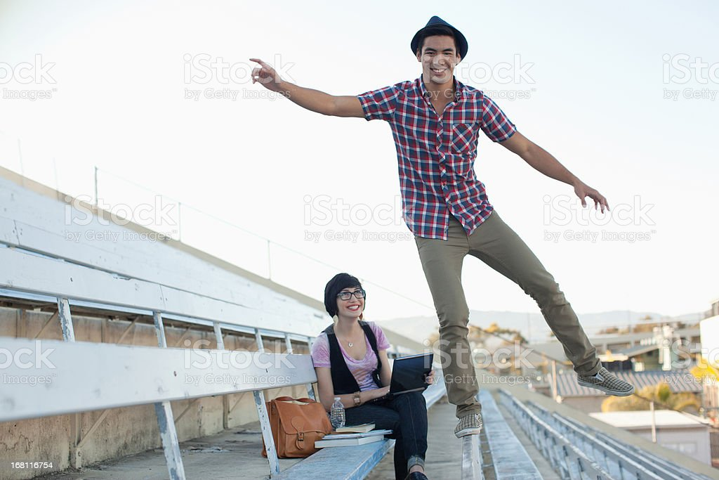 Students relaxing on bleachers stock photo