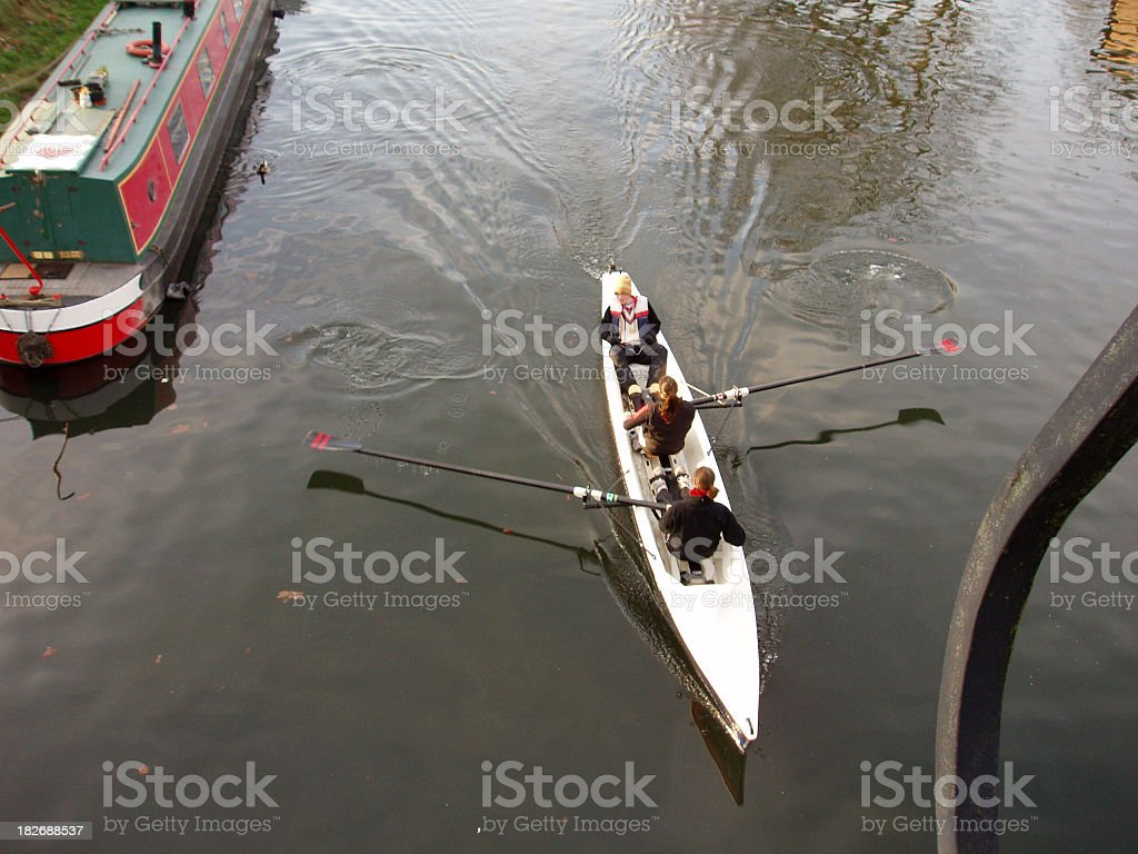 students rowing on the river Cam, Cambridge, England royalty-free stock photo