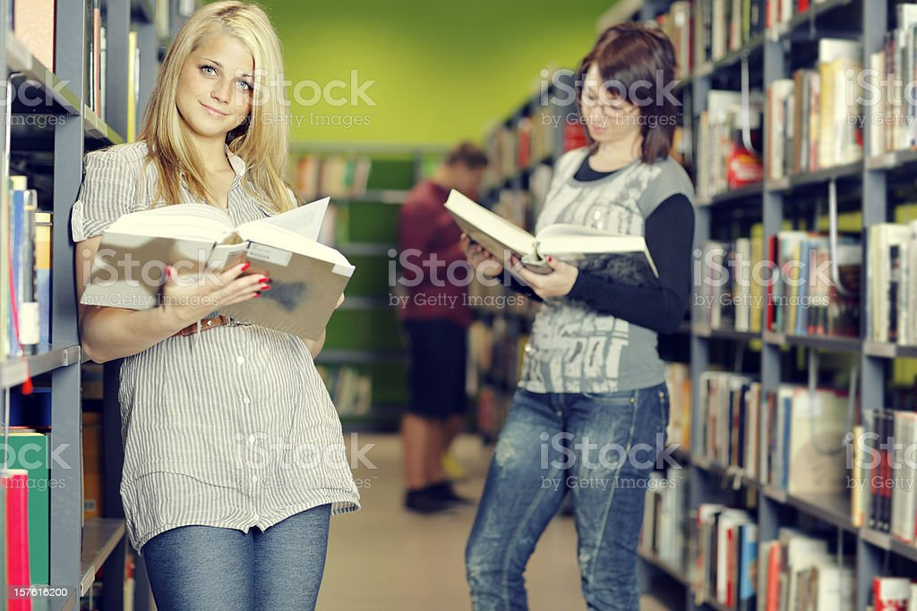 Students searching for study materials in the library. royalty-free stock photo