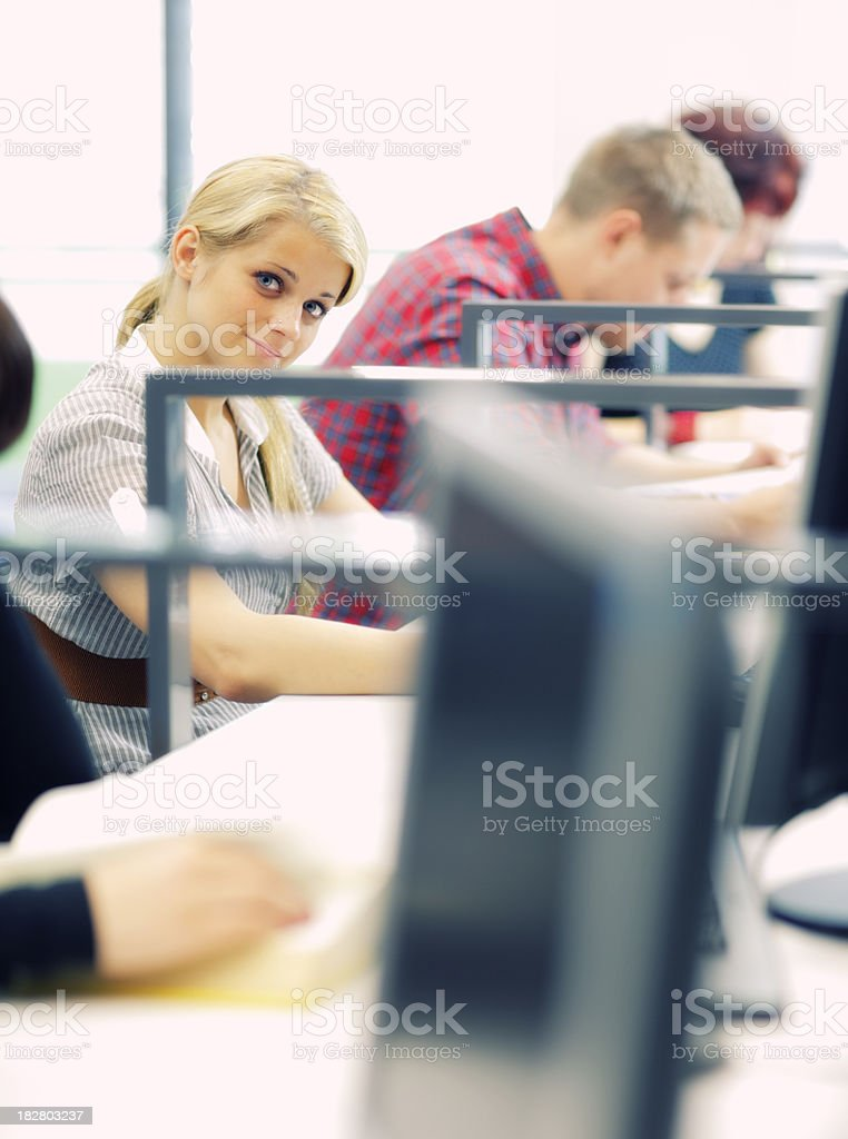 Students searching for study materials in the library. stock photo