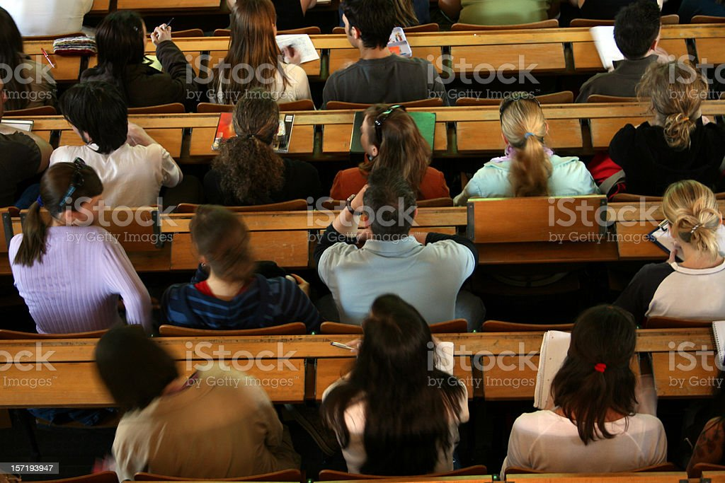 Students sitting in lecture hall at university. Shot from above. royalty-free stock photo