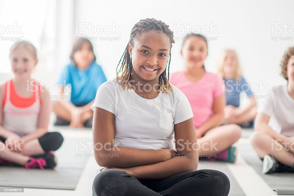 Students Sitting on Their Yoga Mats stock photo