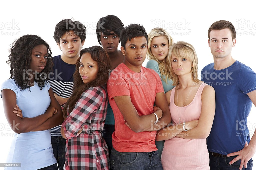 Students standing in a group looking serious royalty-free stock photo
