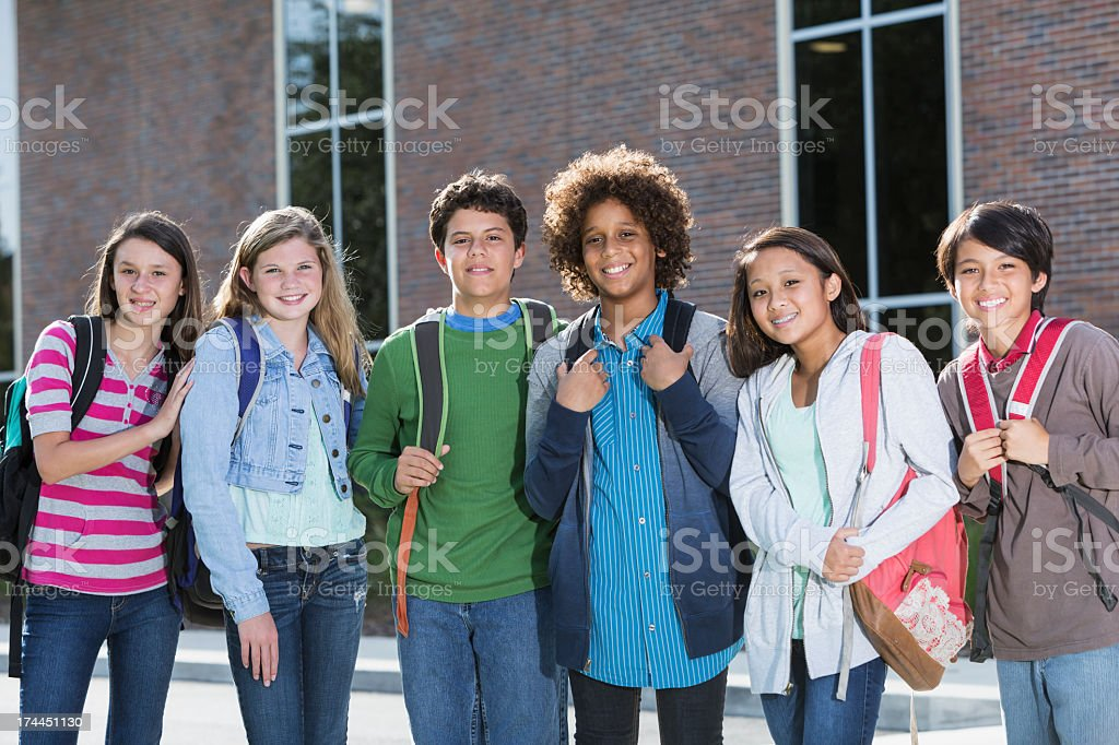 Students standing outside building royalty-free stock photo
