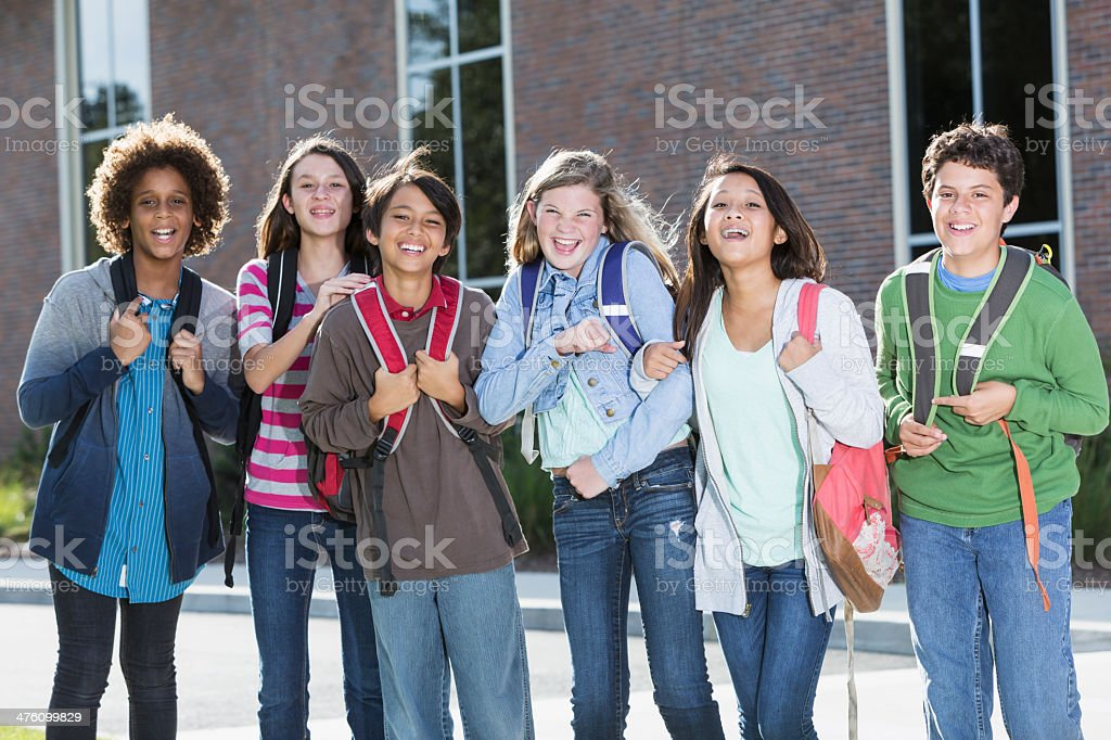 Students standing outside building stock photo