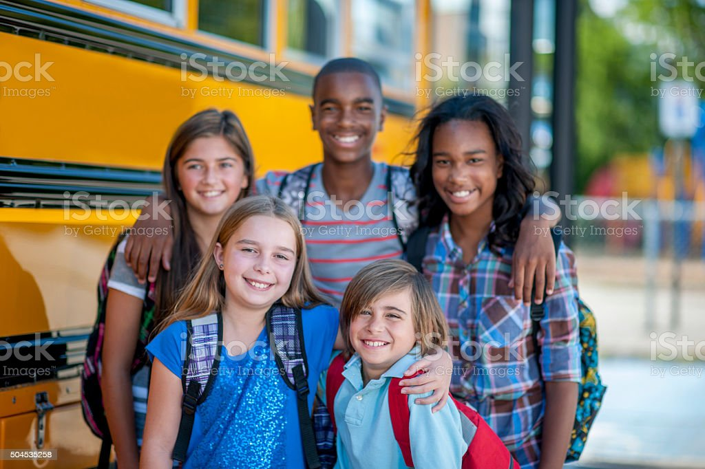 Students Standing Together Before School stock photo