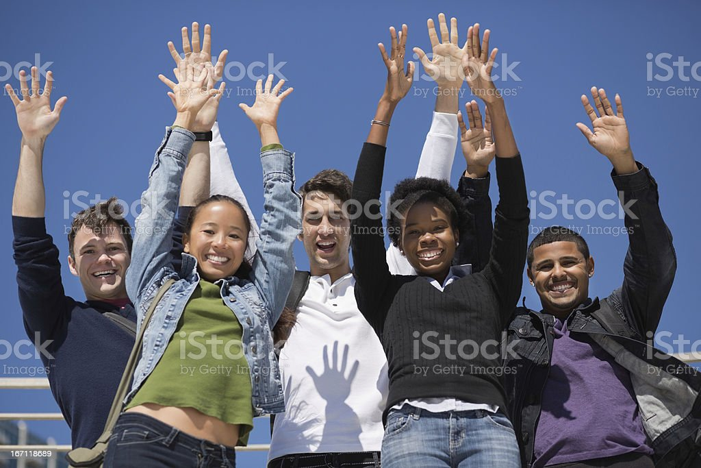 Students Standing With Hands Raised royalty-free stock photo