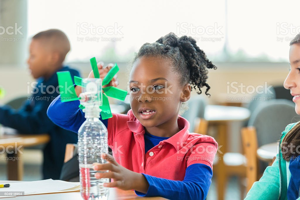 Students studying alternative wind energy during elementary science class stock photo