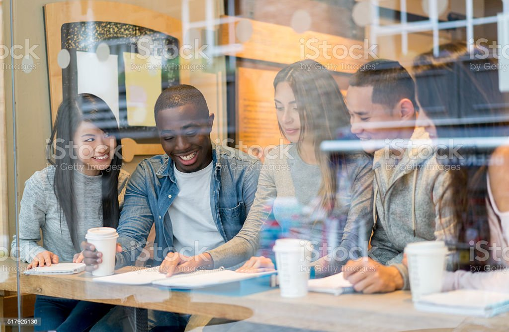 Students studying at a cafe stock photo