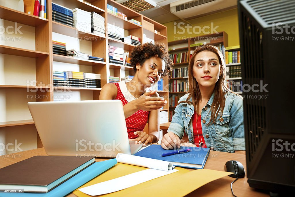 Students studying in a library royalty-free stock photo