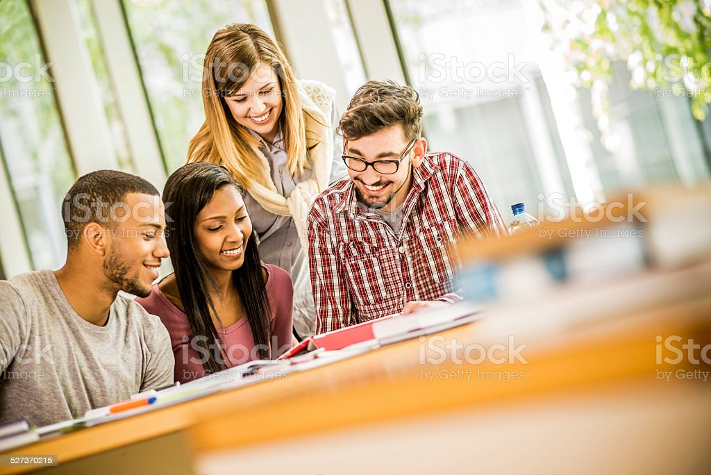 Students Studying in a Library stock photo