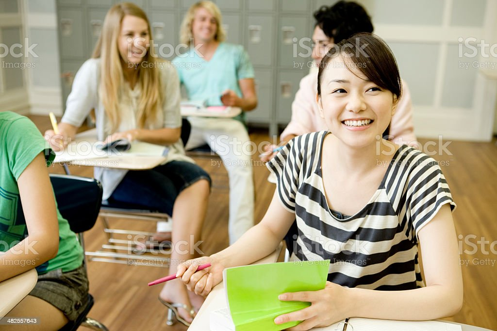 Students studying in classroom stock photo