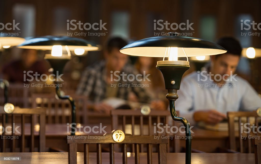 Students Studying In Library stock photo