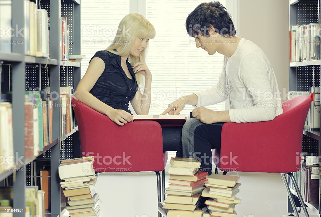 students studying in the library royalty-free stock photo